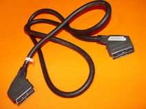 Scart cable / Digital Sat. Scart cable background on orange Stock Image