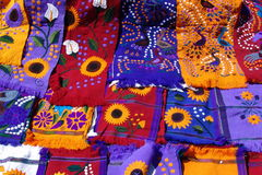 Scarves. Colorful, hand-made indigenous scarves for sale at a market in San Cristobal de las Casas in Chiapas, Mexico Stock Photo