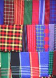 Scarves. Some Plaid scarves.  Some typical Masai blanket Stock Image