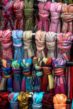 Scarves as souvenirs. Hungary clothing market with colorful scarfs Stock Image