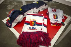 Scarves and caps of Genoa 1893 football team on sale in Genoa Shop at Genoa `Porto Antico` area, Italy royalty free stock images