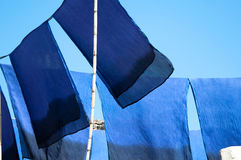 Scarves drying in the sun Stock Images