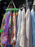 Scarves on Hangers at Street Stall Royalty Free Stock Images