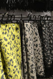 Scarves on racks in fashion store,close up Stock Photo
