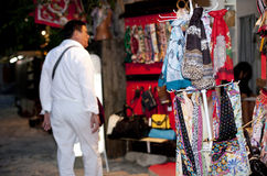 Scarves for Sale. Man shopping in small town Royalty Free Stock Images