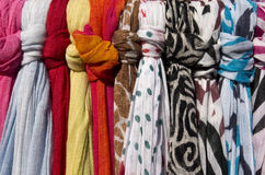 Scarves in a shop. Stock Photos