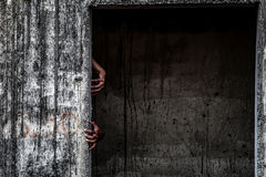scary abandoned building with ghost hand coming out of a door Stock Images