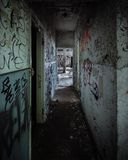 Scary abandoned corridor with hidden hand Royalty Free Stock Photography