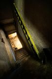 Scary alley. A dark staircase and a ladder Stock Image