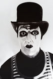 Scary angry  mime wearing a tall hat Stock Photography