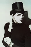 Scary angry mime wearing a tall hat Stock Image