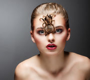 Scary Arachnid Predator on Beauty Woman Face sitting. Spider. Arachnid Monster on Beauty Woman Face Stock Images