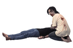 Scary asian male zombie eating corpse Royalty Free Stock Photography