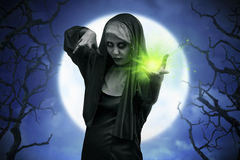 Scary asian nun casting spell Stock Image