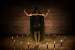 Scary asian witch woman with bloody knife and hand standing on t Stock Images