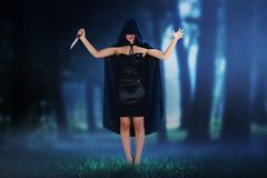 Scary asian witch woman holding knife royalty free stock image
