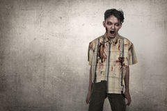 Scary asian zombie man in a clothes standing Stock Photography