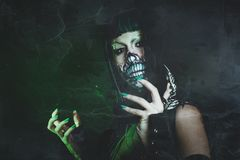 Scary assasin undead woman with finger claw studio Stock Images