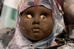 Scary black doll face royalty free stock photo