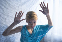 Scary blond girl Stock Images