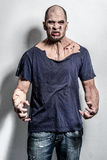 Scary and bloody zombie man. A scary and bloody zombie man Stock Photo