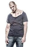 Scary and bloody zombie man. A scary and bloody zombie man Stock Photography