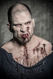 Scary and bloody zombie man Stock Image