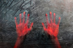 Scary blurred human hands on grunge glass window. Scary red bloody blurry human hands on grunge glass window Royalty Free Stock Photo