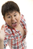 Scary boy. A young Asian boy jump forward to scare the camera Royalty Free Stock Photo