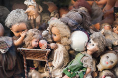 Scary broken doll heads heap in a shop Royalty Free Stock Images