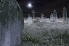 Scary cemetery at night. Composition of a moonlit cemetery with fog, old slabs and crosses. Ideal for Halloween Royalty Free Stock Photos
