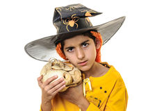 Scary child in Halloween outfit with jack-o-lantern Royalty Free Stock Images