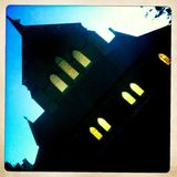 Scary church at night. Scary church with lit windows at dusk. taken with mobile Stock Photography