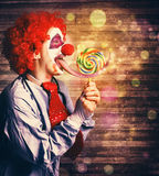 Scary circus clown at horror birthday party Stock Photography
