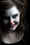 Scary clown. A scary and evil looking female clown
