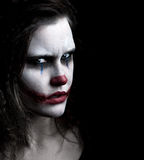 Scary clown. A scary and evil looking female clown Royalty Free Stock Photography