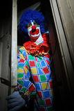 Scary Clown. Lurking around a haunted house Stock Photography