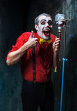 The scary clown and drip with blood on dack background. Halloween concept Royalty Free Stock Photography