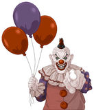 Scary Clown. The scary clown holds balloons Royalty Free Stock Images