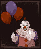 Scary Clown. The scary clown holds balloons Stock Photo