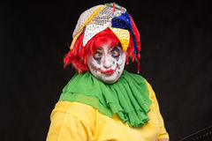 Scary clown joker with a smile and red hair on a black backgroun Royalty Free Stock Images