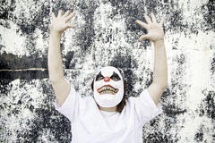 Scary clown mask. Crazy clown mask halloween costume and fear royalty free stock photography