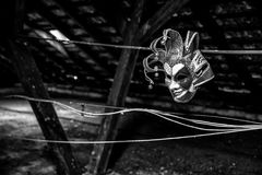 Scary clown mask. On black background stock photo