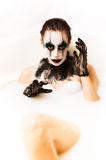 Scary clown milk bath Royalty Free Stock Images