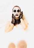 Scary clown milk bath Royalty Free Stock Photos