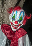 Scary Clown. With red hair and sharp teeth