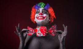 Scary clown with spooky makeup and more candy Royalty Free Stock Image