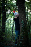Scary clown in the wood Stock Images