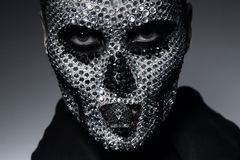 Scary creative woman with skull. In studio Stock Photo