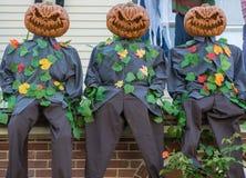 Scary creepy pumpkin head men. Halloween decorations Royalty Free Stock Images